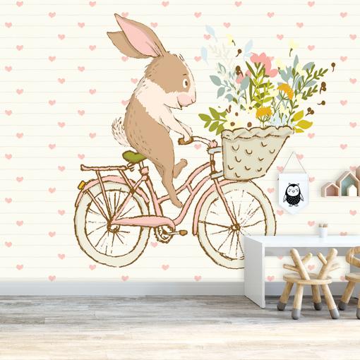 królik jadący na rowerze