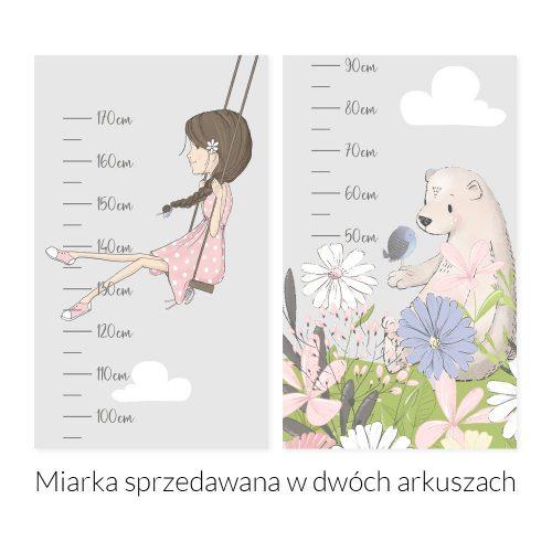 Miarka wzrostu z dziewczynką i kwiatami