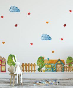 naklejka z motywem zwierząt, domków i chmurek